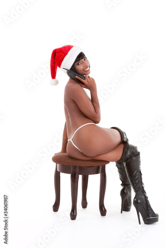 Mrs. Santa Claus talking on Christmas sex phone