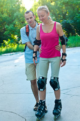 Sport skates training . Young couple