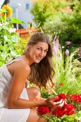 Garden in summer - happy woman with flowers