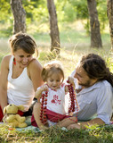 Happy family having picnic in summer park