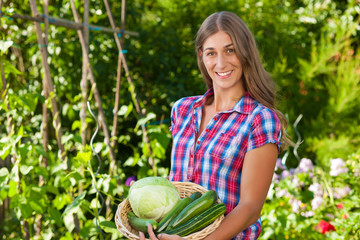 Gardening in summer - woman with vegetables