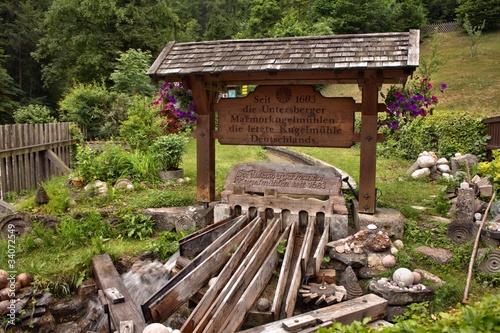 Leinwanddruck Bild Kugelmühle an der Almbachklamm