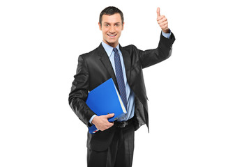 Businessman holding a fascicule with documents and giving thumb