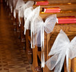 White bows in Catholic Church.