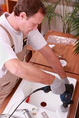 Handyman installing a sink