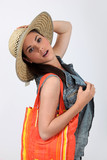 Woman with bag wearing straw hat