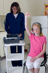 School nurse giving hearing test
