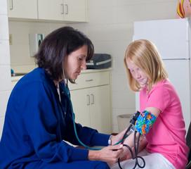 School nurse checking blood pressure