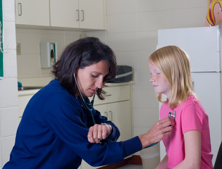 Nurse with Stethoscope checking student patient
