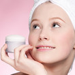Beautiful woman tender jar of moisturizer cream