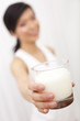 Asian Chinese Girl Holding Glass of Milk to Camera