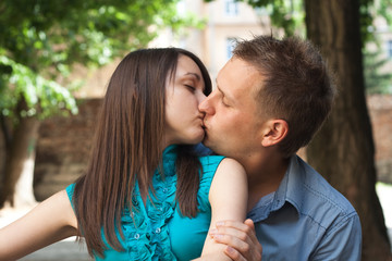 Love young couple kissing in the street