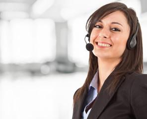Happy phone operator smiling