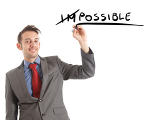 "Businessman changing the word ""impossible"" to ""possible"""