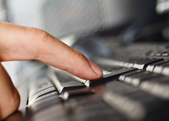 Close-up of a finger pressing the enter key on a keyboard