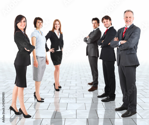 Group of happy businesspeople in a bright room