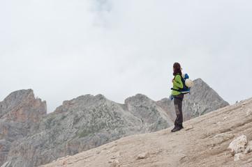 Mountain scenery with trekker. Dolomites, Italy.