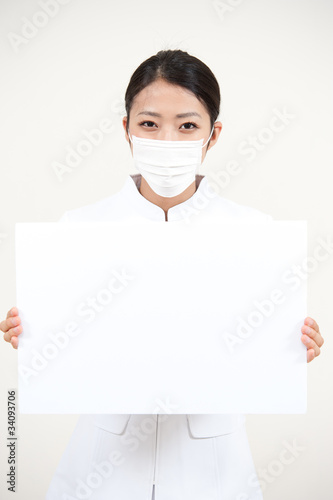 beautiful asian nurse holding a blank whiteboard