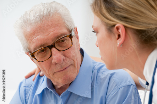 Consoling elder man