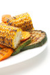 Grilled carrot, corn and zucchini on а plate