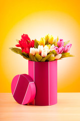 Giftbox and tulips against gradient background