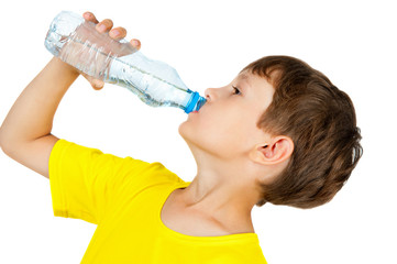 boy drinks water from a bottle