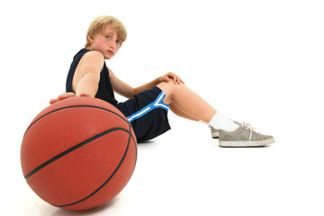 Teen Boy Child in Uniform Sitting with Basketball