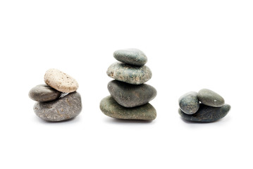 A few stones of different sizes, isolated on white.