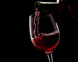 Red wine on a black background