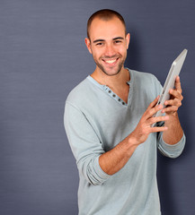 Young man holding touchpad