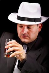 black suit gangster drinking