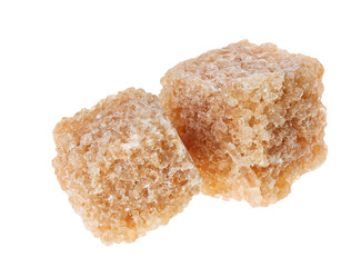 Two brown lump cane sugar cubes, isolated on white