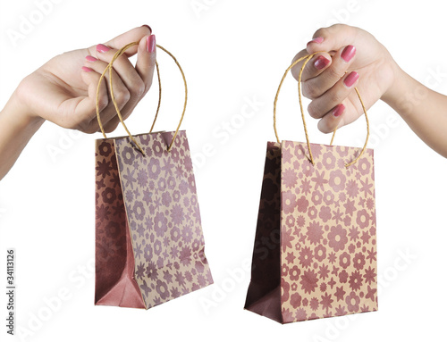 woman hand carrying shopping bags