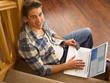 Young Hispanic man shopping online