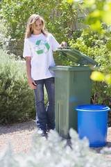 Woman looking into recycling bin