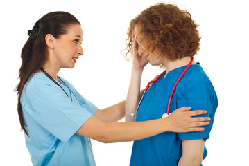 Doctor comforting her colleague
