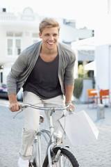 Smiling young man cycling