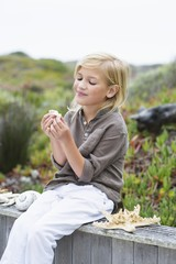 Girl playing with shells