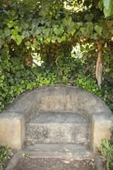 Stone seat in a garden