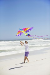 Mid adult man flying kite