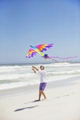 Mid adult man flying kite