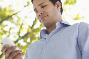 Mid adult man using a mobile phone