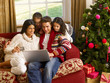 Hispanic family Christmas shopping online