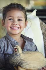 Portrait of a little girl holding model of turkey