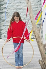 Girl holding a plastic hoop