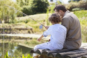 Father and son fishing in a lake
