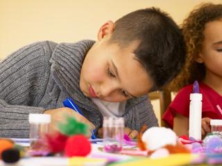 Young mixed race children doing handicrafts