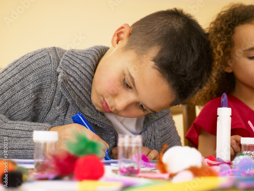 Young mixed race children doing handicrafts