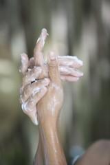 Close-up of a woman's hands with soap sud while bathing