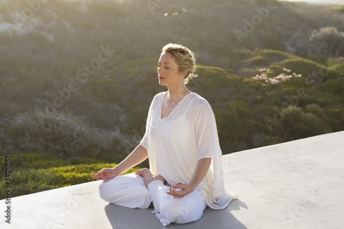 Mid adult woman meditating